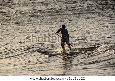 Silhouette Surfer at Sunset in Tenerife Canary Island Spain