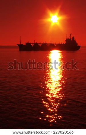 silhouette tanker  at sunset - stock photo