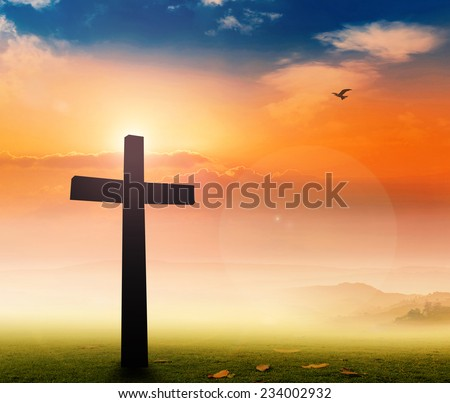 Silhouette the cross over a sunset background. - stock photo