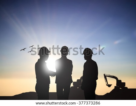 silhouette three back people engineer talking Business  in a building site over Blurred construction site. examination, inspection, survey - stock photo