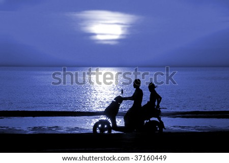 Silhouette two young people go on motor scooter on moon night