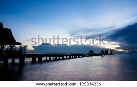 Silhouette view of temple building was not completed in the Pattaya Bay. - stock photo