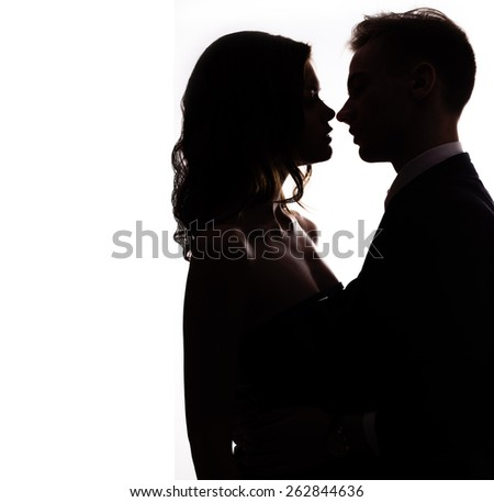 silhouette vlublennoj happy couple kissing on a white background - stock photo