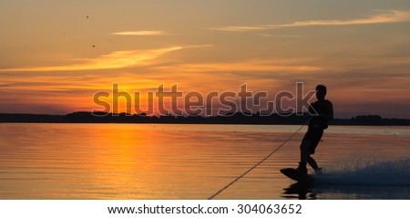 Silhouette Wakeboarder making tricks on sunset. Ukraine river Dnepr