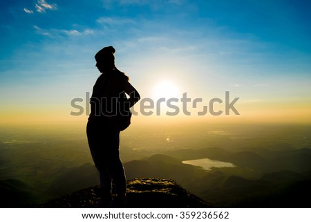 silhouette  woman with mountains landscape ,shadow tone