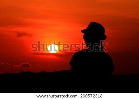 Silhouette woman with the sunset in holiday