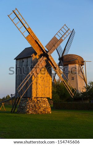 Silhouette wooden windmills in Angla, Saaremaa Island, Estonia - stock photo