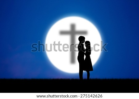 Silhouette  young couple over blue and moon background,