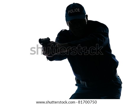 Silhouetted Afro American police officer aiming handgun isolated on white background - stock photo