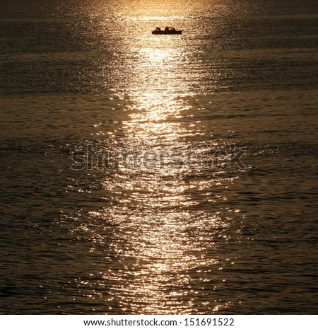 Silhouetted fisherman boat during sunrise, Bulgaria