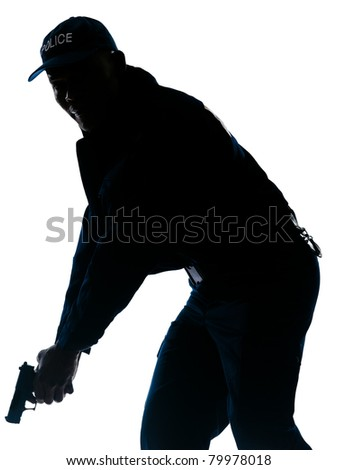 Silhouetted image of afro American policeman holding handgun in studio on white isolated background - stock photo
