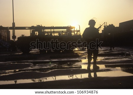 Silhouetted National Guard during 1992 riots, South Central Los Angeles, California - stock photo