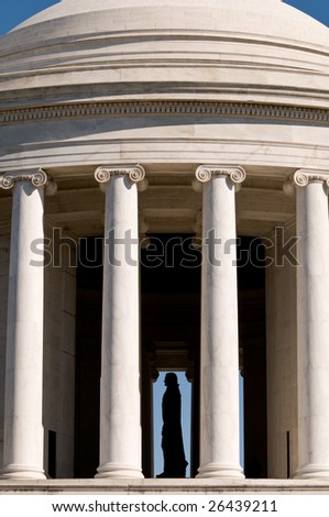 Silhouetted statue of Thomas Jefferson inside memorial in Washington DC - stock photo