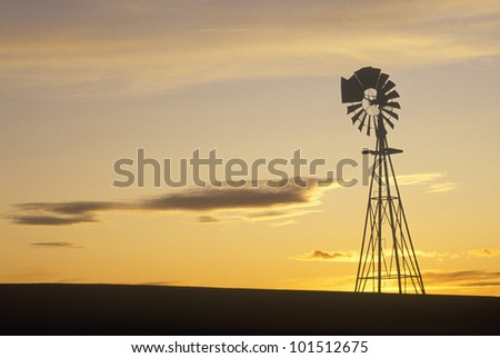 Silhouetted wooden windmill at sunset, South Dakota