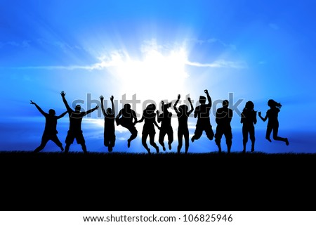 Silhouettes of a celebratory group jump in field of grass, bright sun behind - stock photo