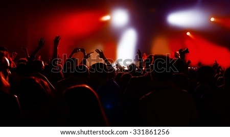 silhouettes of a crowd party concert music happy - stock photo
