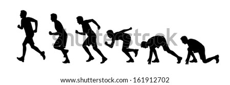 silhouettes of a young man starting running a marathon - stock photo