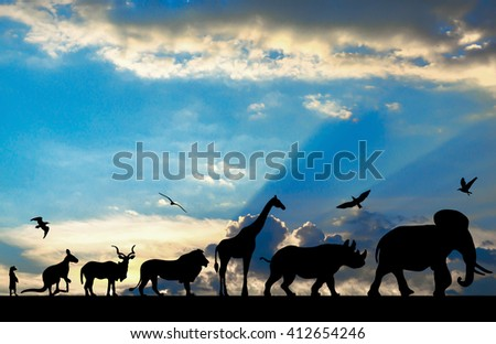 Silhouettes of animals on blue cloudy sunset background