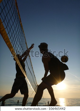 silhouettes of beachvolleyball players - stock photo