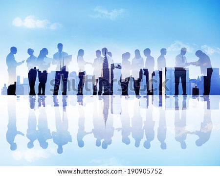 Silhouettes of Business People Communicating in a Cityscape - stock photo