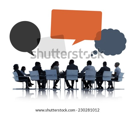 Silhouettes of Business People Discussing Teamwork - stock photo