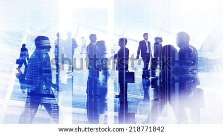 Silhouettes of Business People in an Office Building - stock photo