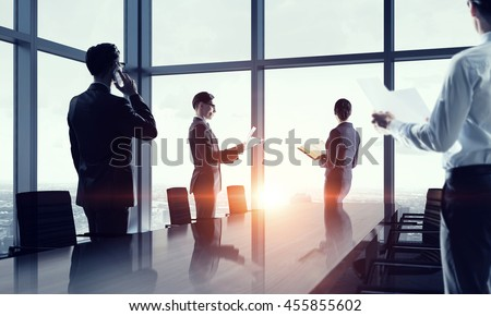 Silhouettes of Business People in Office. Mixed media .