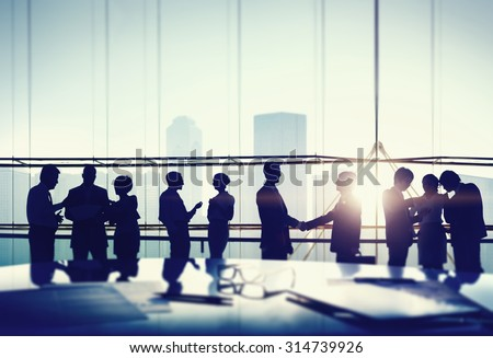 Silhouettes of Business People Meeting Handshake Concept - stock photo