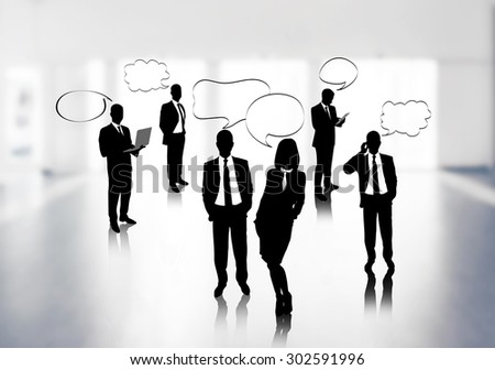 Silhouettes of business people with speech bubble on office background - stock photo