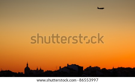 Silhouettes of central part of Lisbon at sunset - stock photo
