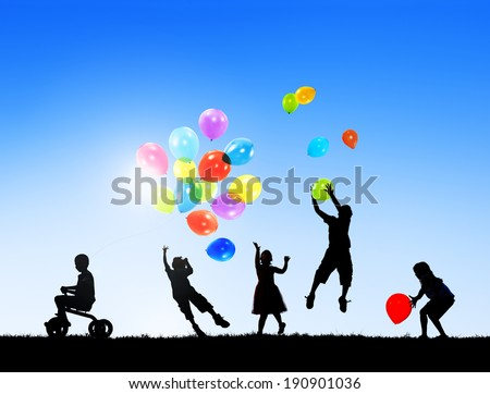 Silhouettes of Children Playing With Balloons - stock photo