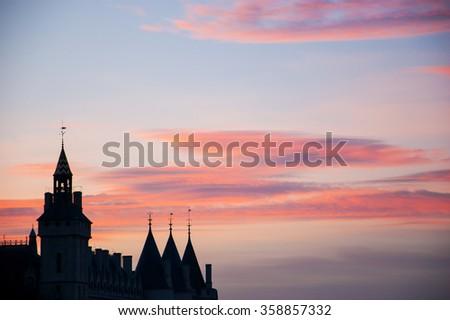 Silhouettes of Conciergerie building (former prison) at sunset. Paris, France. - stock photo