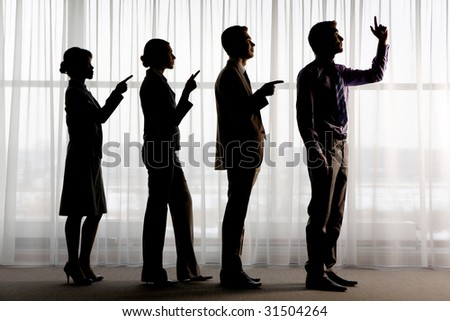 Silhouettes of contemporary business people standing in line with pointing forefingers