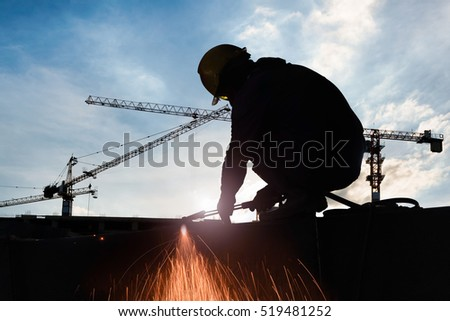 Silhouettes of expatriate worker to cutting steel in construction site with Oxy-Propane cutting