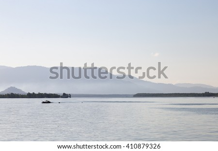 Silhouettes of fishing boats. Fishing boats sailing in the sea. During the morning, the cold - stock photo