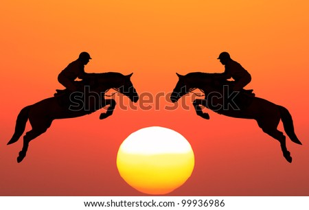 Silhouettes of horses with equestrians on the sunset background - stock photo
