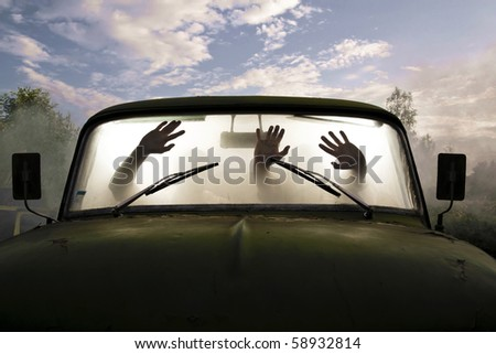 silhouettes of passengers in car full of smoke - stock photo