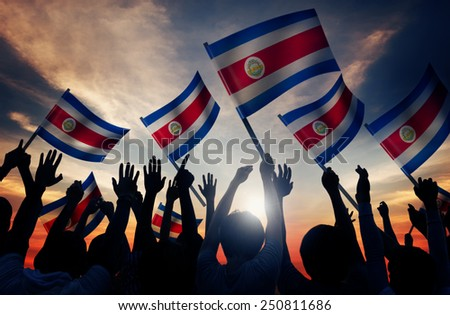 Silhouettes of People Holding Flag of Costa Rica