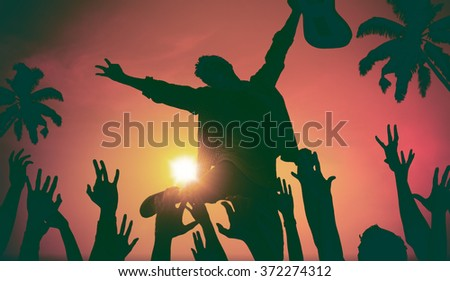 Silhouettes of People in Music Festival by the Beach Concept