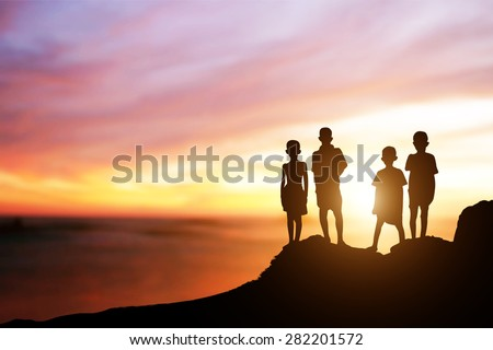 silhouettes of Rohingya Children were evacuated by boat  on the rocks of the sea.