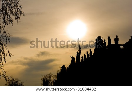Silhouettes of statues on the roof of the museum - stock photo