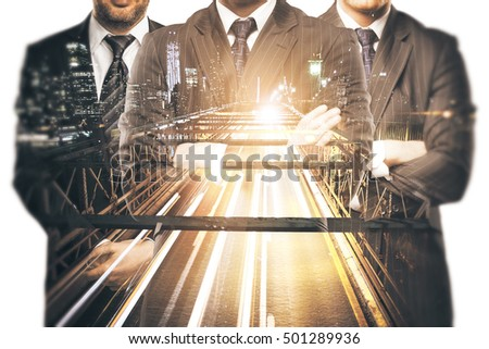 Silhouettes of three businessmen in suits and with folded arms on abstract night city road background. Double exposure. Teamwork, partnership and leadership concept