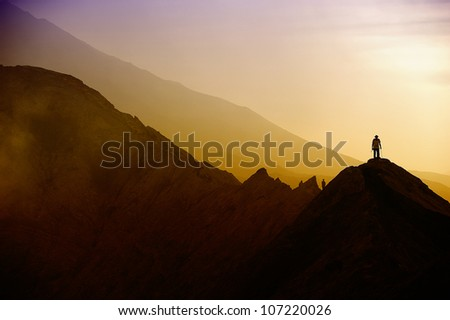 Silhouettes of tourists on Bromo mountain - stock photo