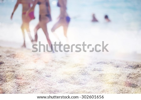 Silhouettes of young group of girlfriends walking on a beach - stock photo