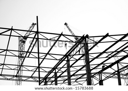 Silhouettes on construction, Black and white photo.
