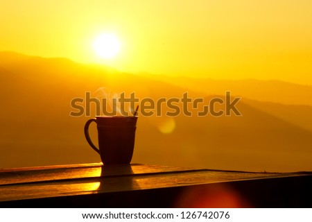Silhouettes on sunrise morning coffee. - stock photo