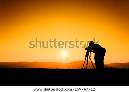 Silhouettes photographers - stock photo