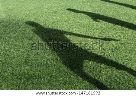 Silhouettes soccer players on the field turf - stock photo