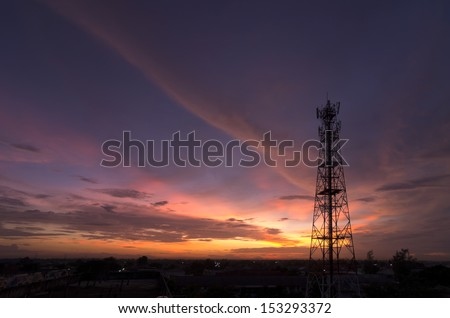 Silhouettes telecommunication tower at sunset. Beautiful sky. - stock photo