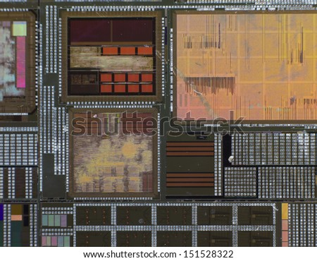 Silicon wafer with printed electronic circuit compared to a niddle - stock photo
